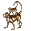 Kultaiset apinat koriste hyllyyn